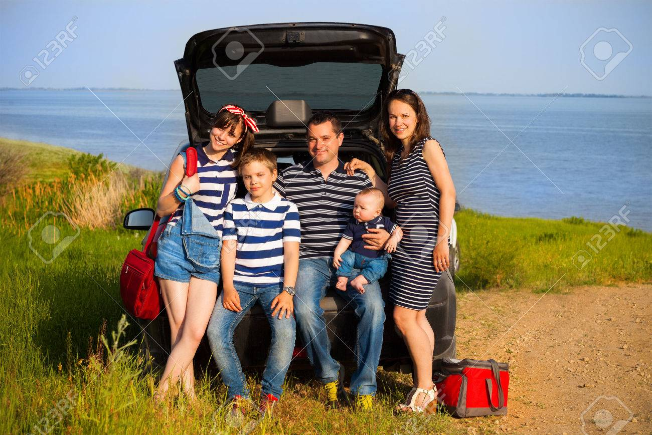 Family of five having fun on the beach going on summer vacation. Car travel and summer vacation concept - 41175419