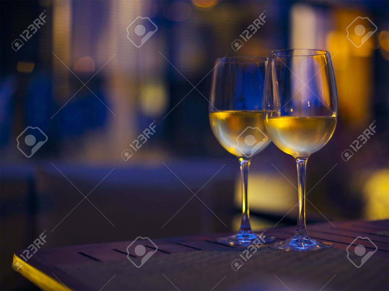 Two glasses of the white wine in the night. Close up. DOF - 42426765