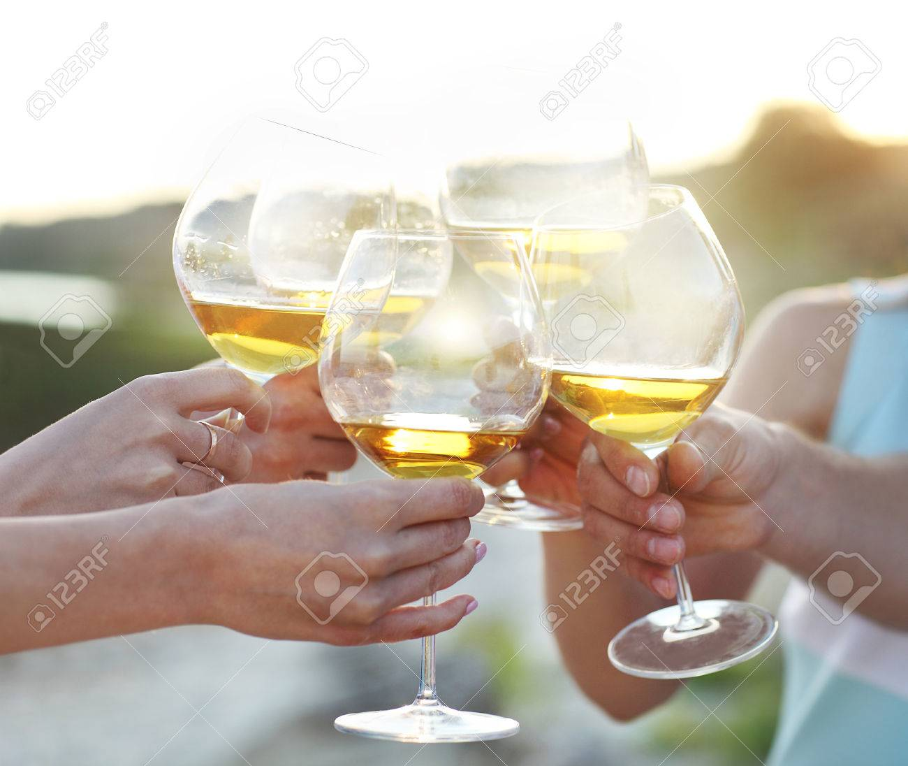 Celebration. People holding glasses of red wine making a toast - 43555333