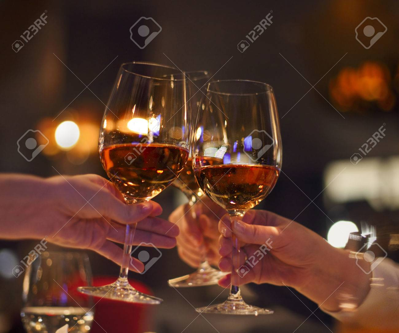 Toast in restaurant with full glasses of rose wine. Celebration concept - 47008383