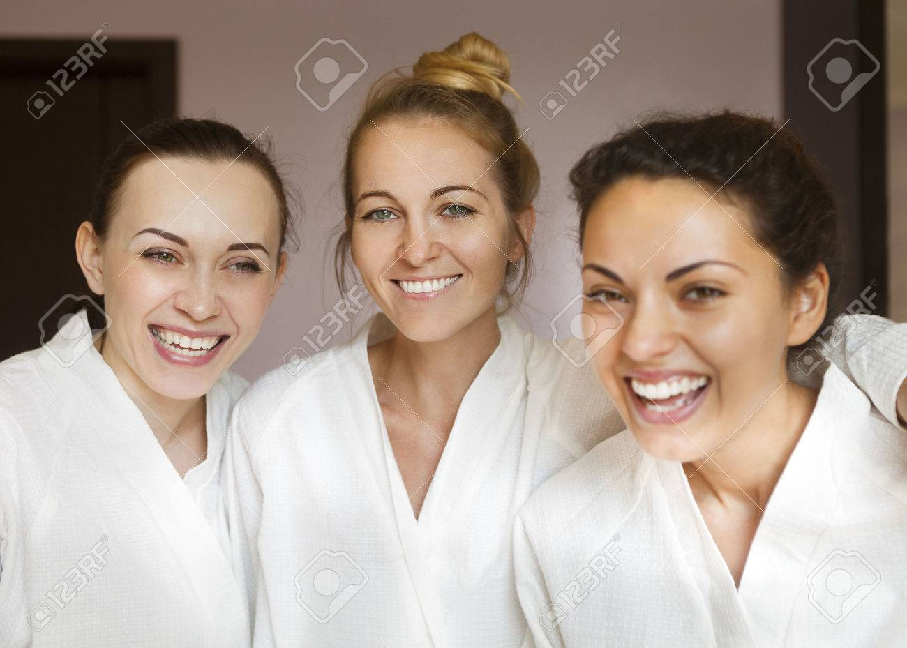 Three young happy women at spa resort. Frenship and wellbeing concept - 47707826