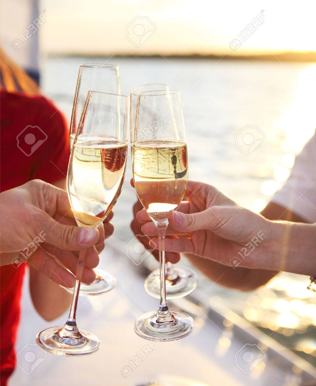 Happy friends with glasses of champagne on yacht. Vacation, travel, sea and friendship concept. Closeup. - 52315481