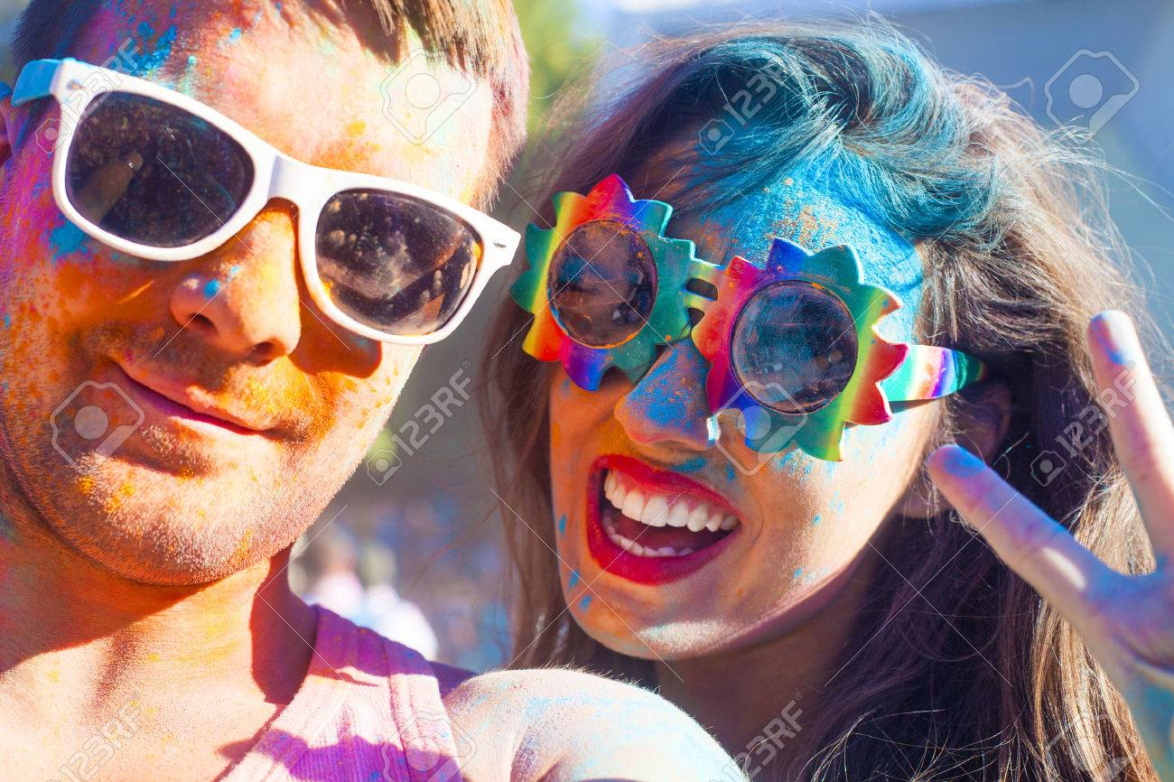 Portrait of happy couple in love on holi color festival - 52803062