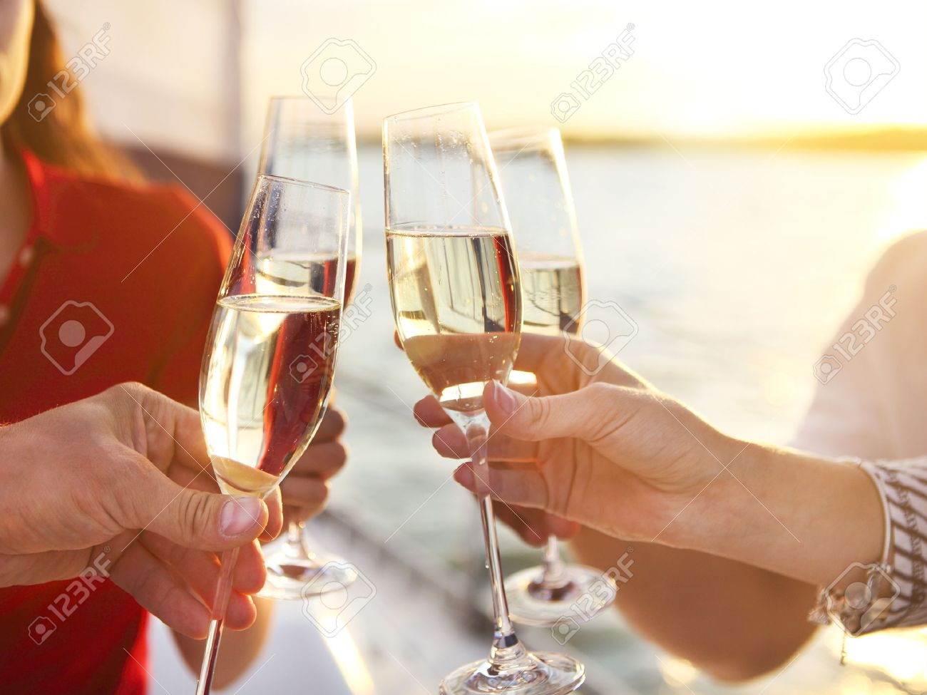 Happy friends with glasses of champagne on yacht. Vacation, travel, sea and friendship concept. Closeup. - 53651761