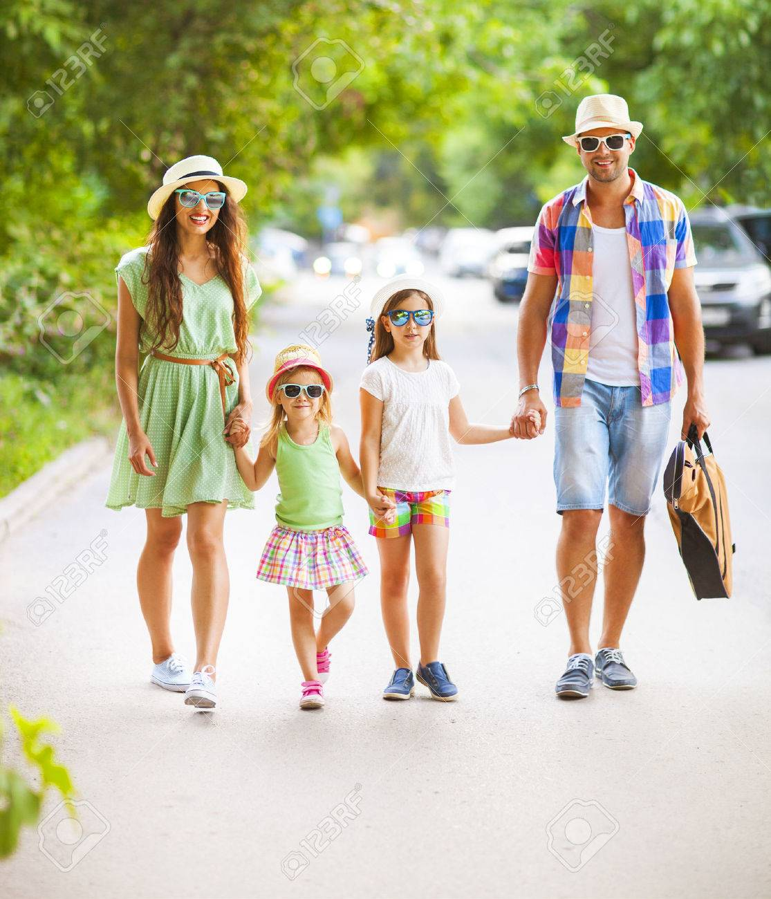 Happy young family walking with guitar spending carefree time together. Travel and holiday concept - 53770050