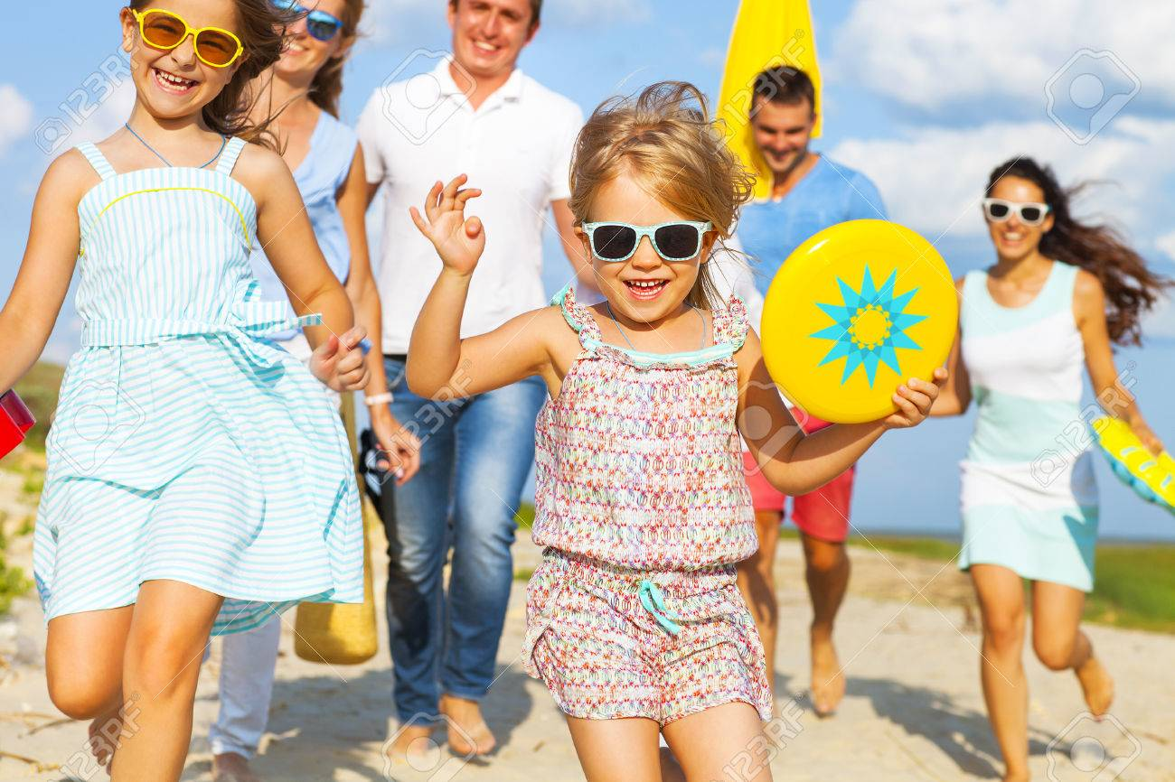 Multiracial group of friends with children walking at the beach - 55846772