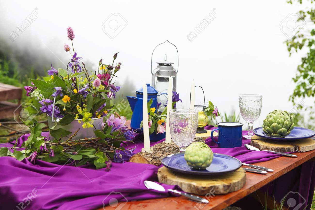 Wedding table setting decorated in rustic style. Mountains view - 71158965