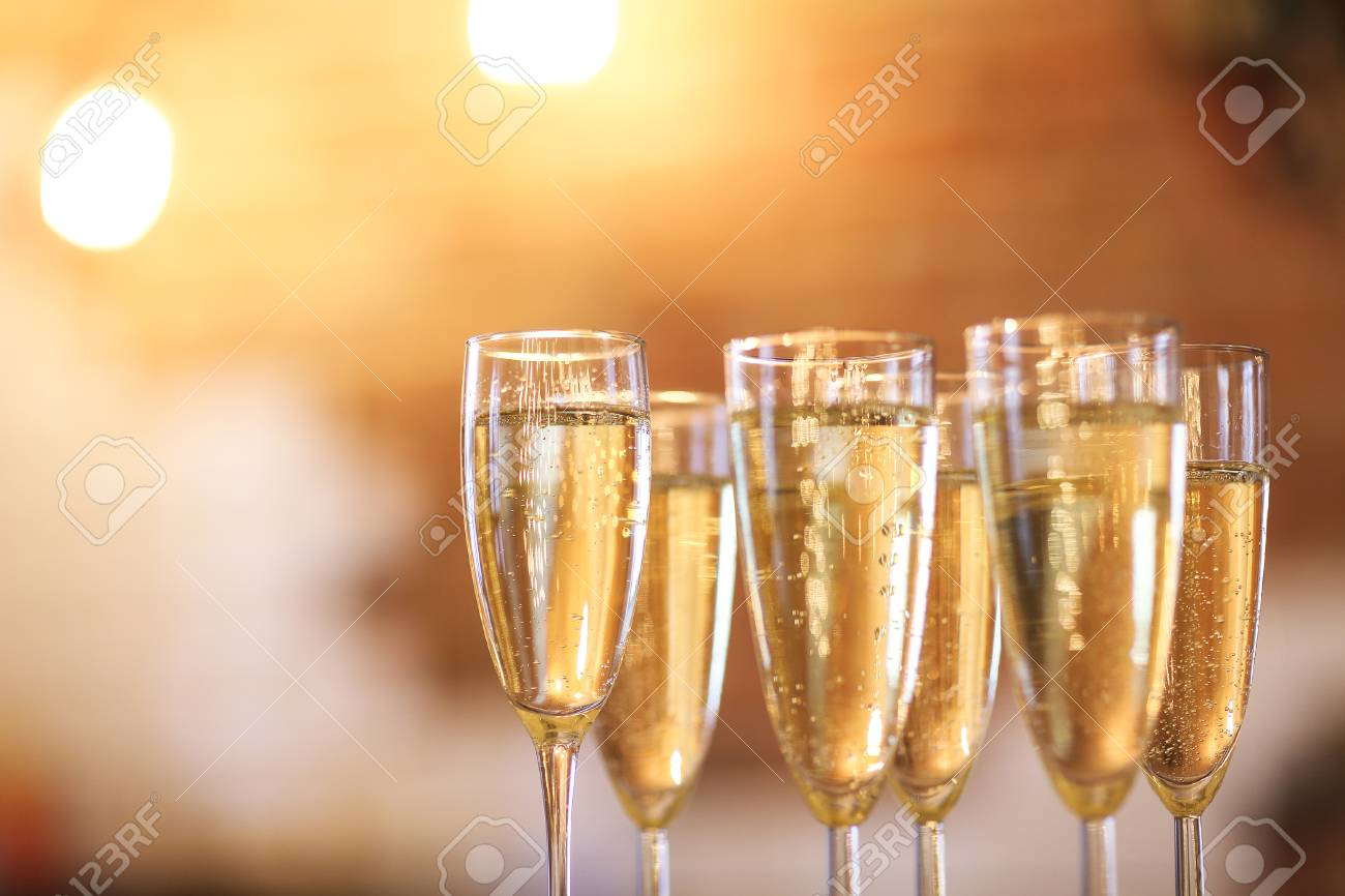 Champagne glasses on gold background. Party and holiday celebration concept - 84811980