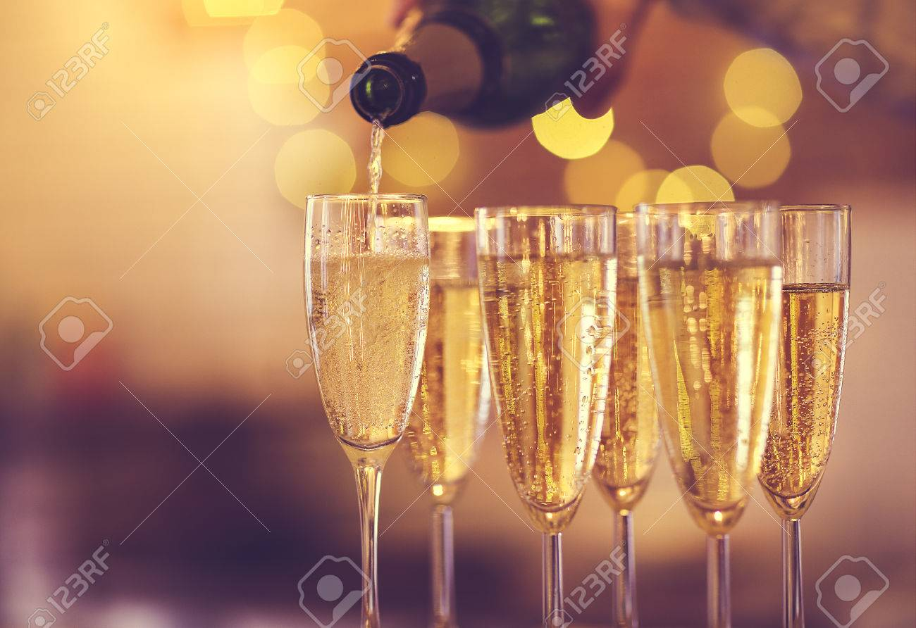 Champagne glasses on gold background. Party and holiday celebration concept - 84932416