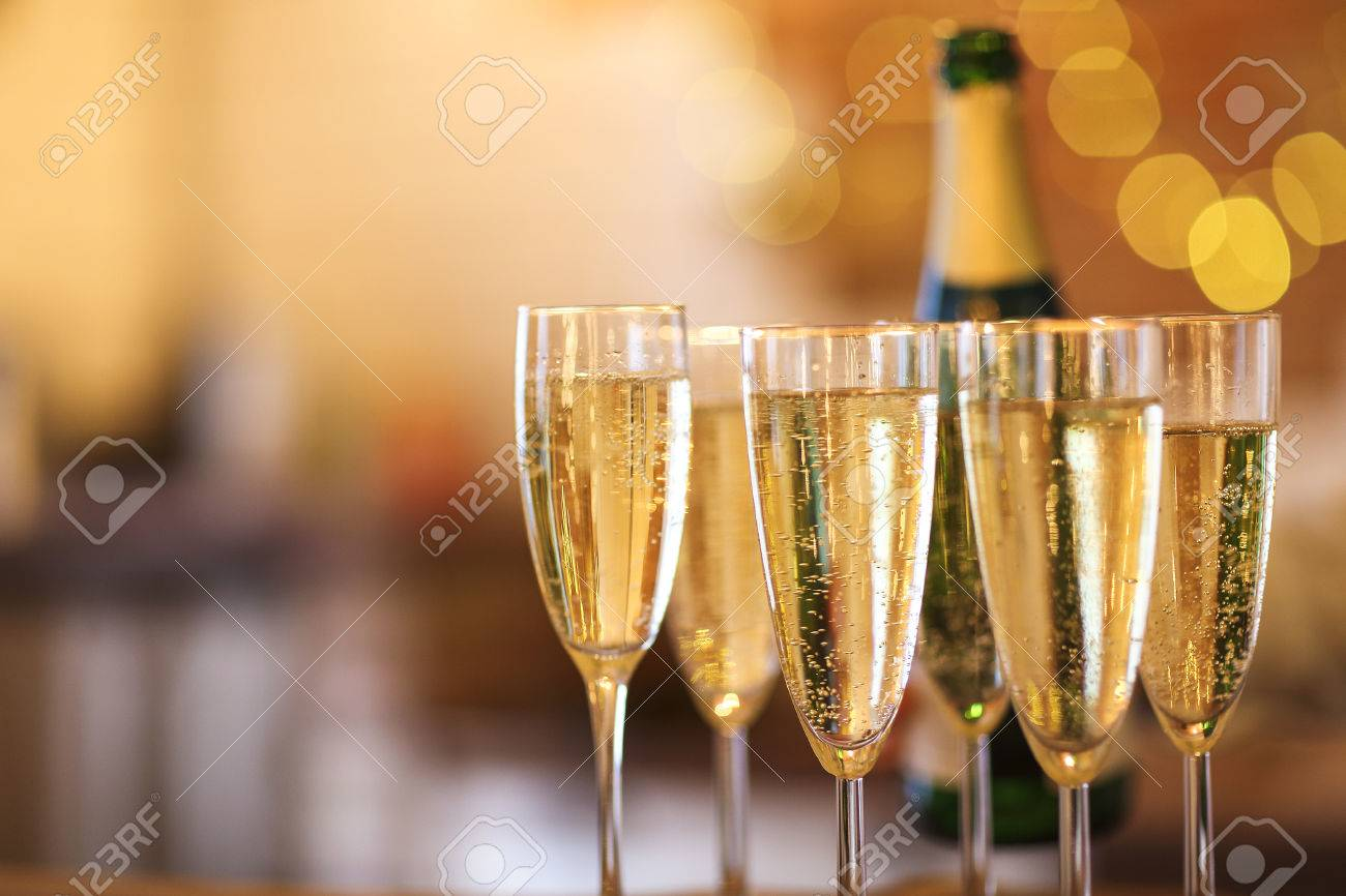 Champagne glasses on gold background. Party and holiday celebration concept - 84954009