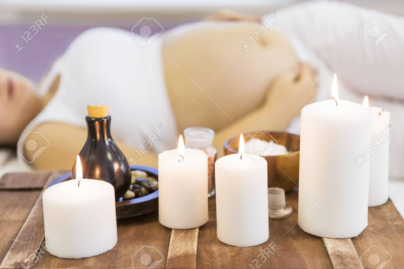 Young pregnant woman have massage treatment at spa salon - 87552382