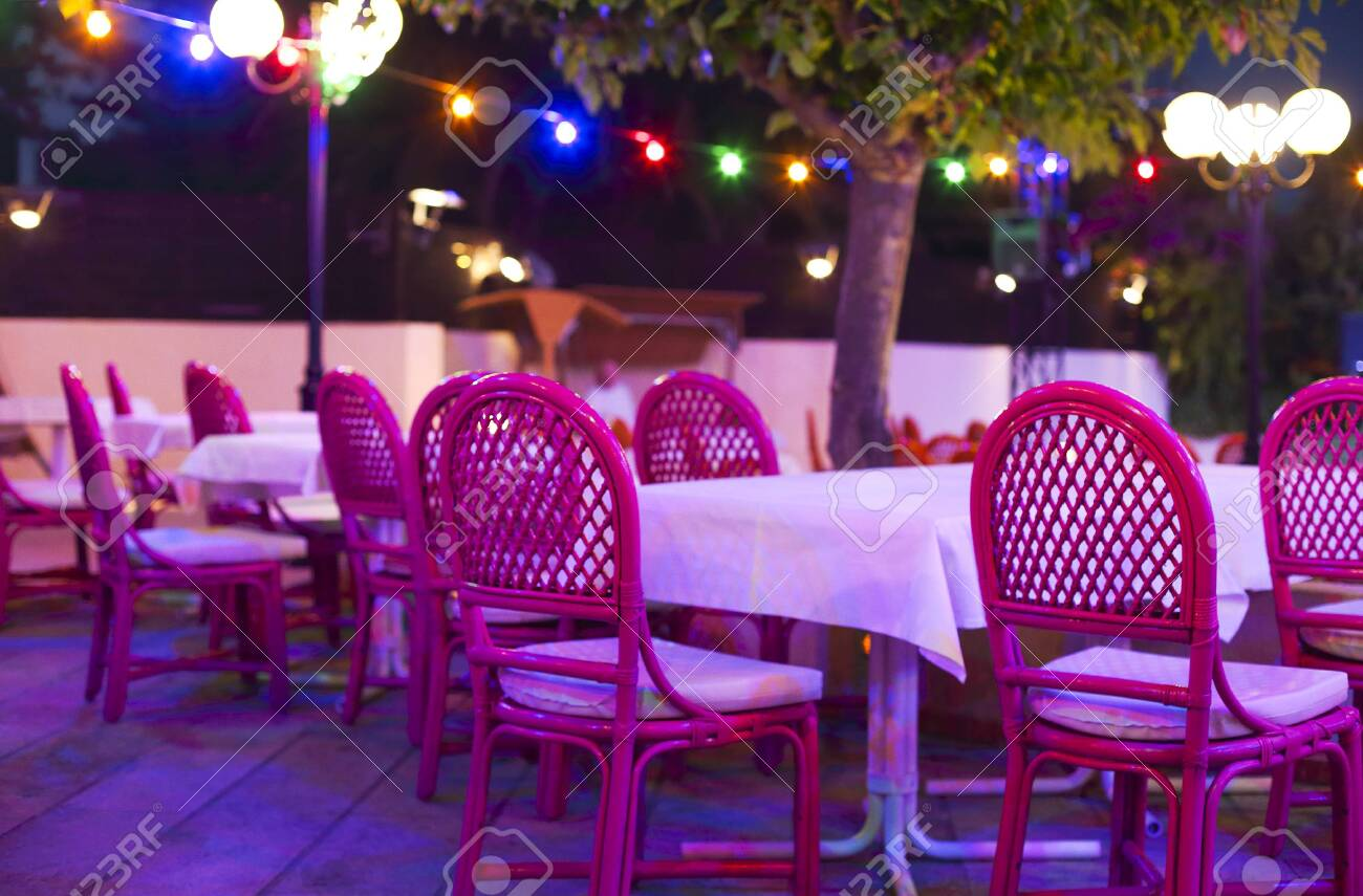 Outdoor Restaurant With Pink Chairs With Lights During Sunset Stock Photo Picture And Royalty Free Image Image 118550726