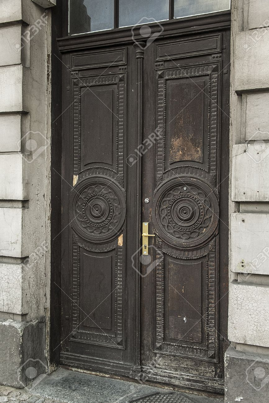 Old brown wooden antique doors in grey house Stock Photo - 25070996 - Old Brown Wooden Antique Doors In Grey House Stock Photo, Picture