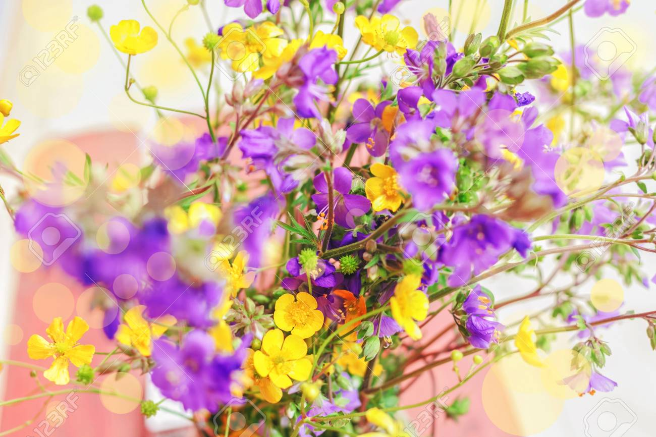 Pretty Summer Bouquet Of Yellow And Purple Flowers Stock Photo