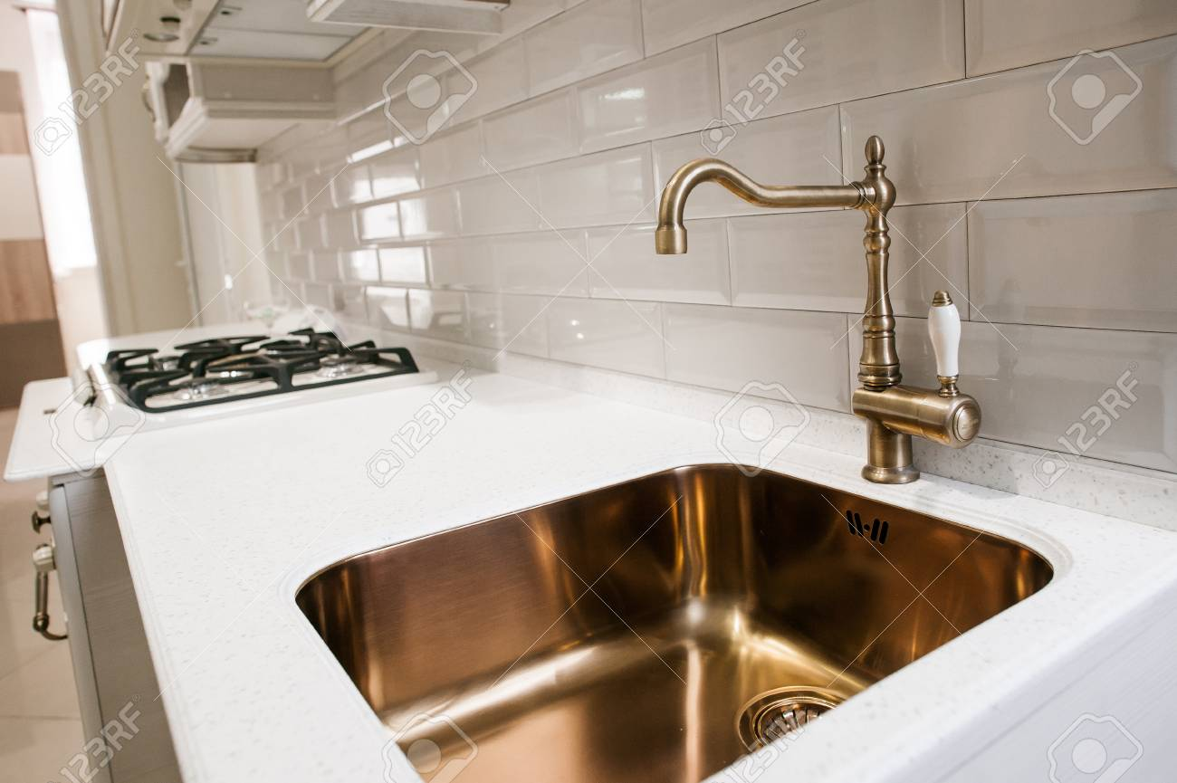 Angle view of kitchen sink with gold faucet Stock Photo - 72563753 & Angle View Of Kitchen Sink With Gold Faucet Stock Photo Picture And ...
