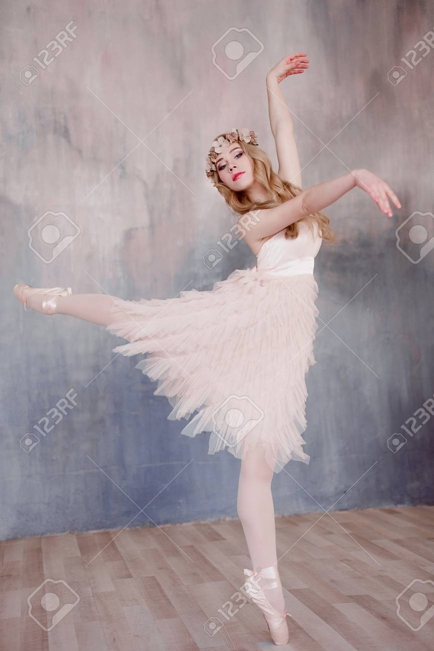 Beautiful Legs Of Young Ballerina Who Puts On Pointe Shoes At