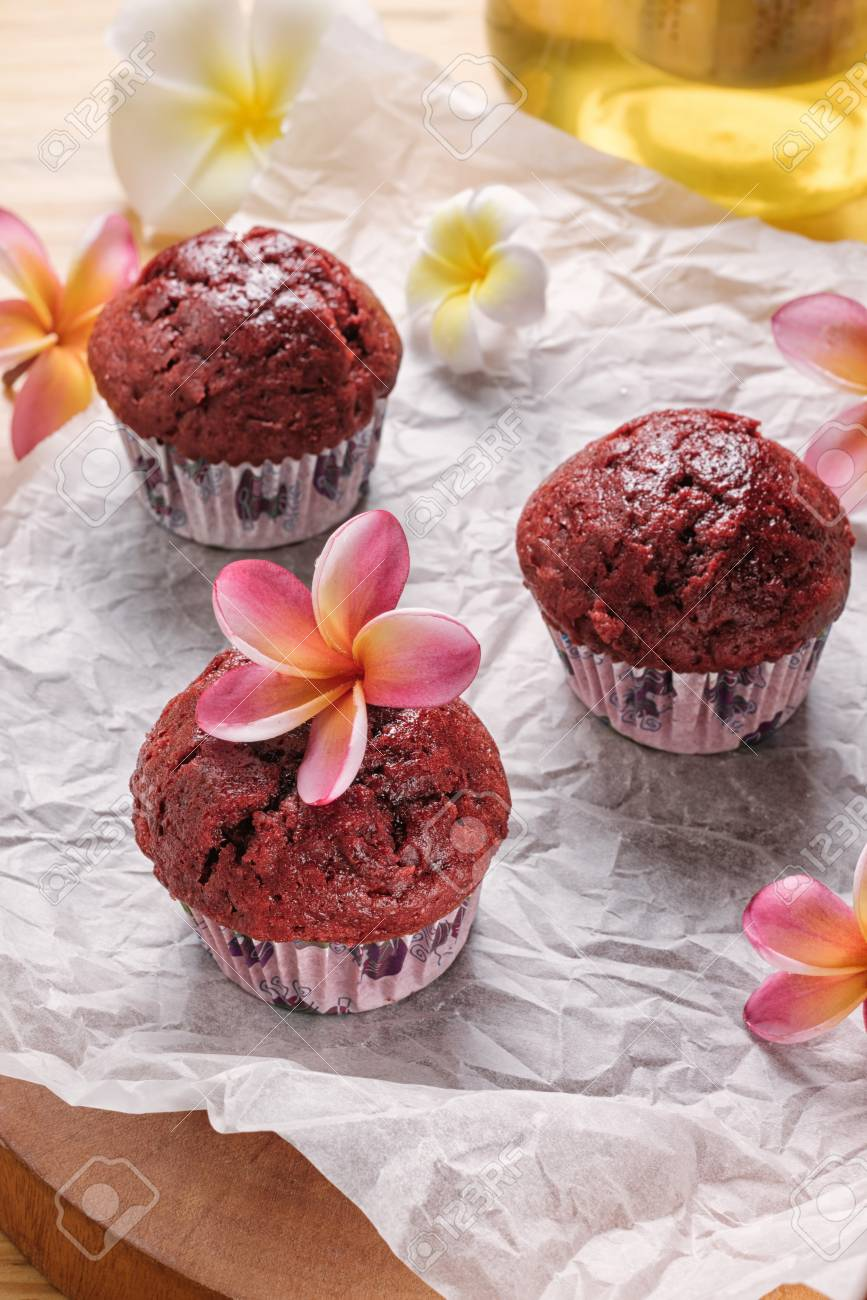 Red Velvet Cupcakes Without Cream Cakes On Baking Parchment Rustic Wooden Background With Plumeria
