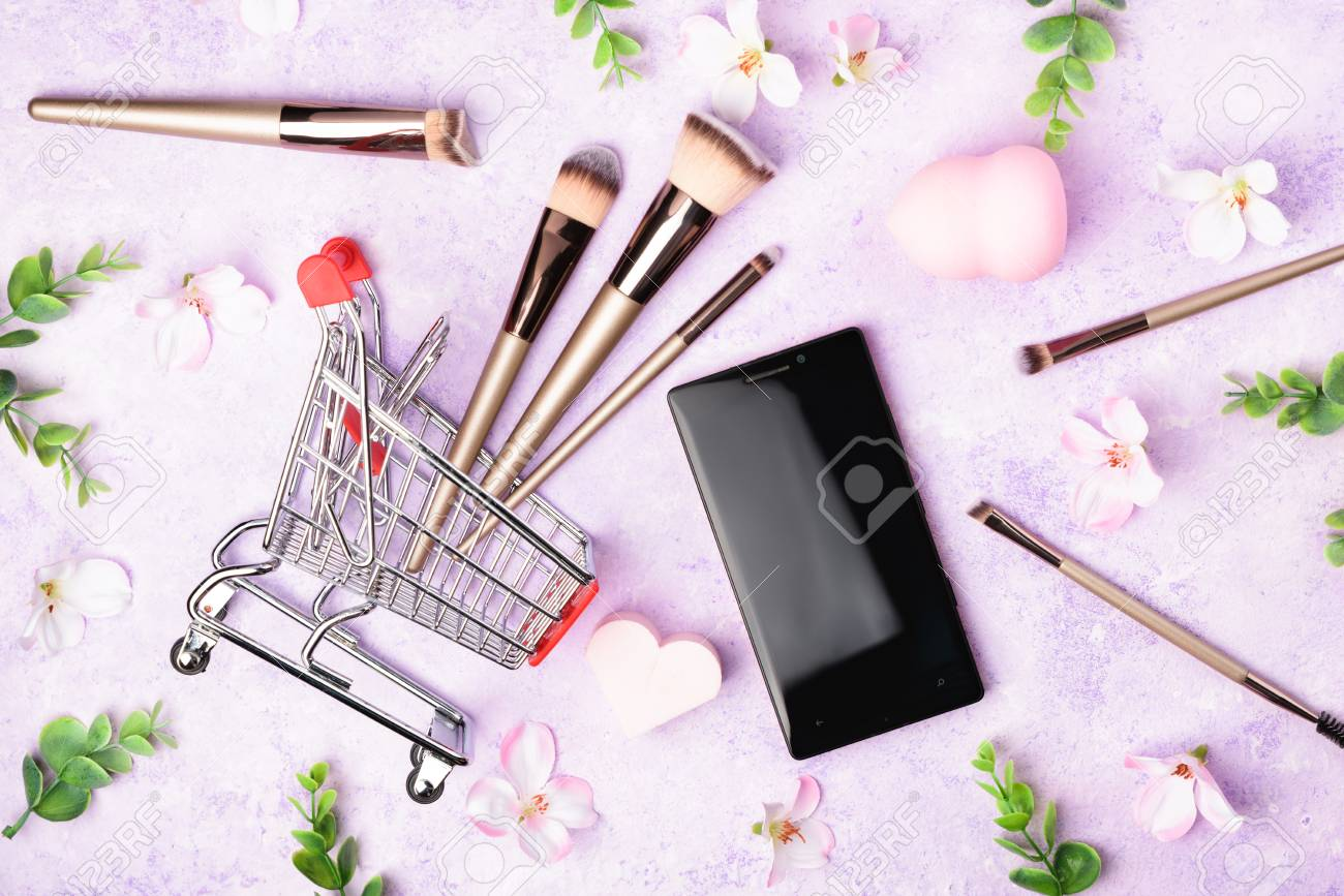 Set of makeup brushes on pink background  Cosmetic, beauty blender