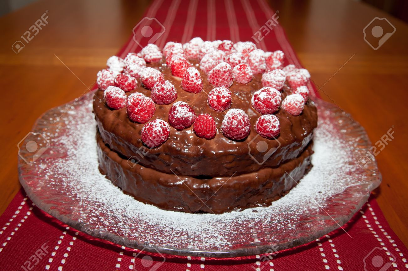 Whole Delicious Birthday Cake With Chocolate Ganache And Raspberries