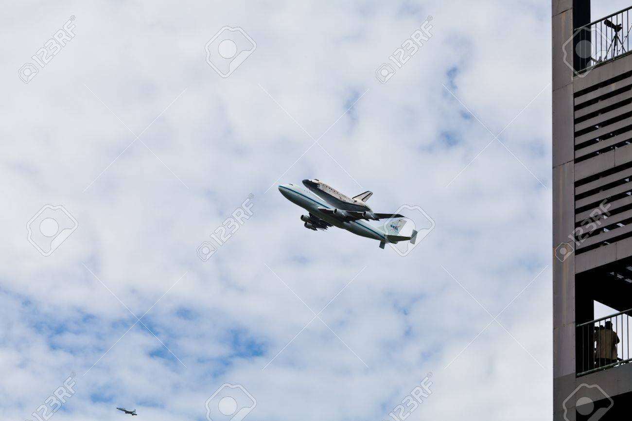 April 17, 2012 - Washington, DC, U S  Space shuttle Discovery, mounted on the Shuttle Carrier Aircraft, has flown over the Washington, D C  area seen next to the Netherlands Carillon Stock Photo - 13243970