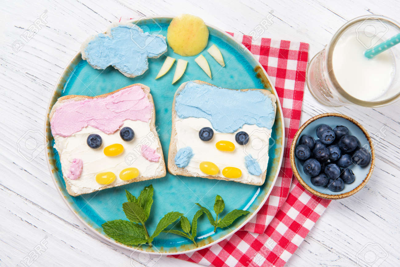 Cute penguin toasts with spread on a plate, food for kids ideas, top view - 155954053