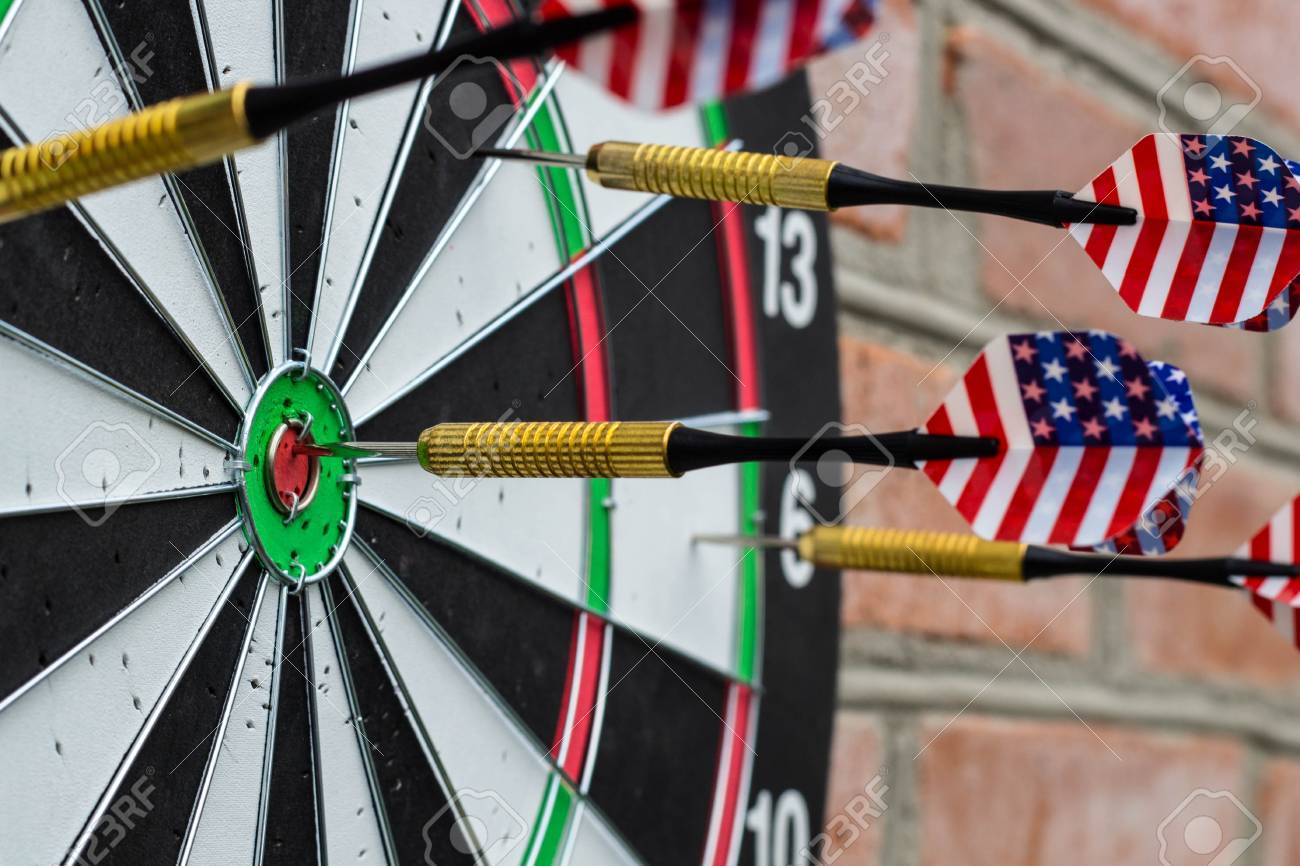 dart in bullseye on the target with many other darts the concept