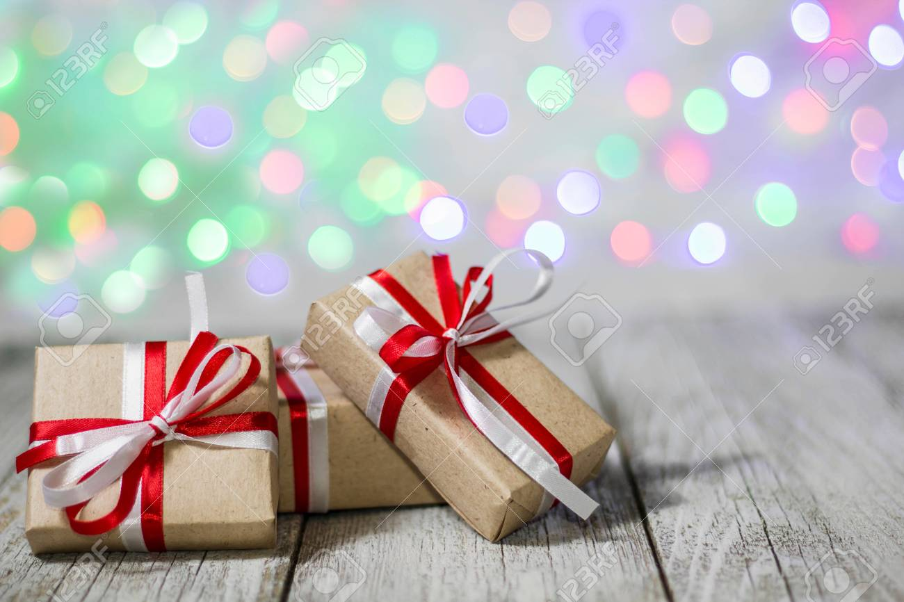 Christmas Gift Box Against Bokeh Background. Holiday Greeting ...