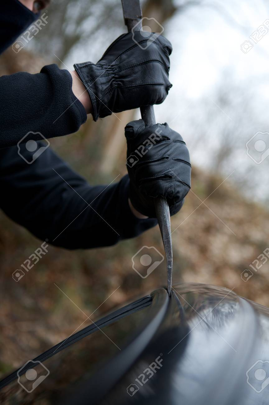 thief hand's car in action property vilolation Stock Photo - 4365216
