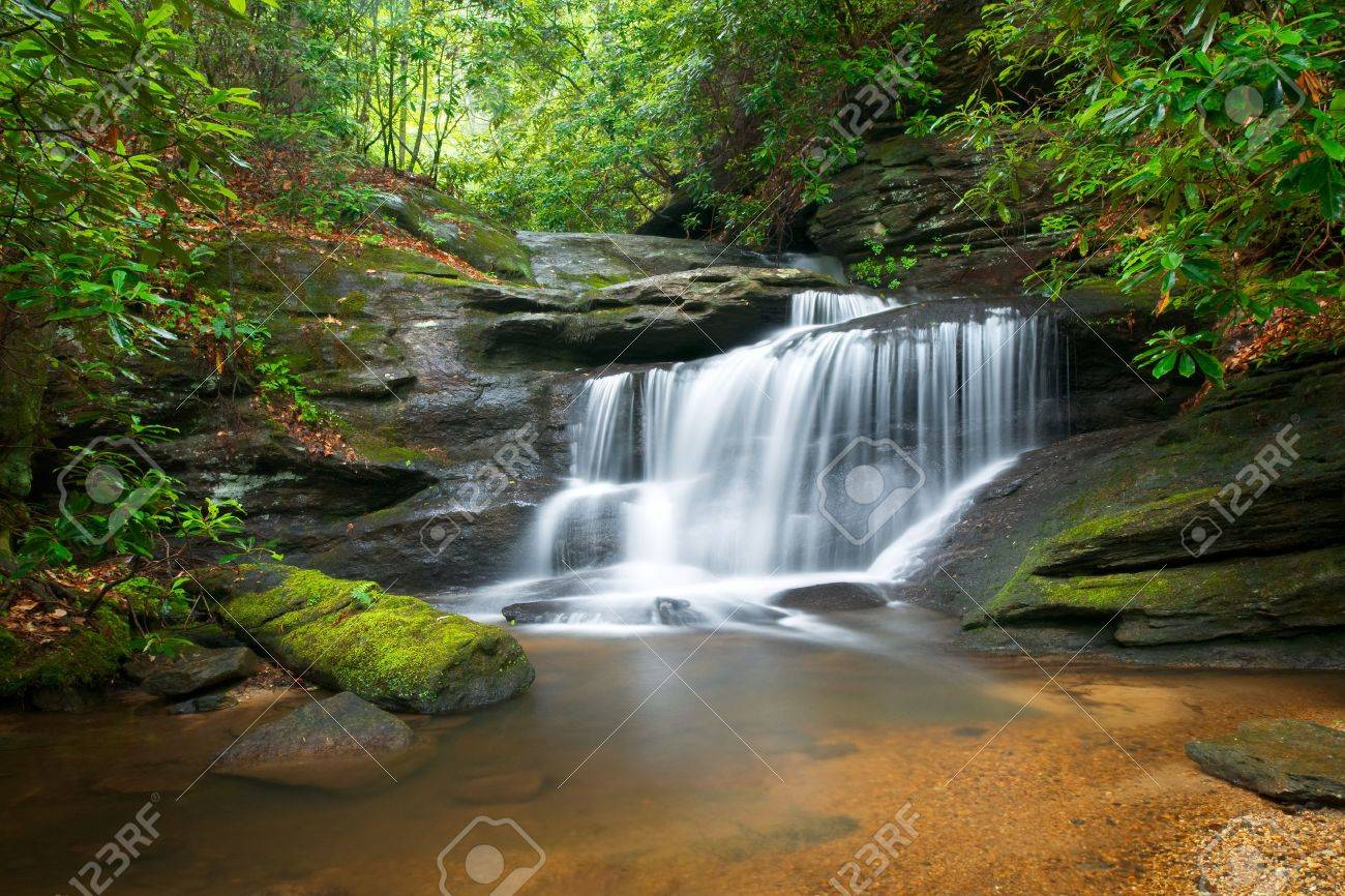 Motion Blur Waterfalls Peaceful Nature Landscape in Blue Ridge Mountains with lush green trees, rocks and flowing water Stock Photo - 7216513