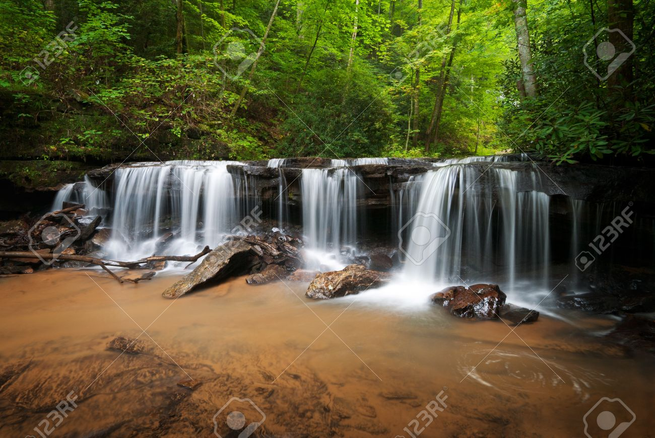 Peaceful Forest Waterfalls Landscape Flowing in Summer Stock Photo - 7656195