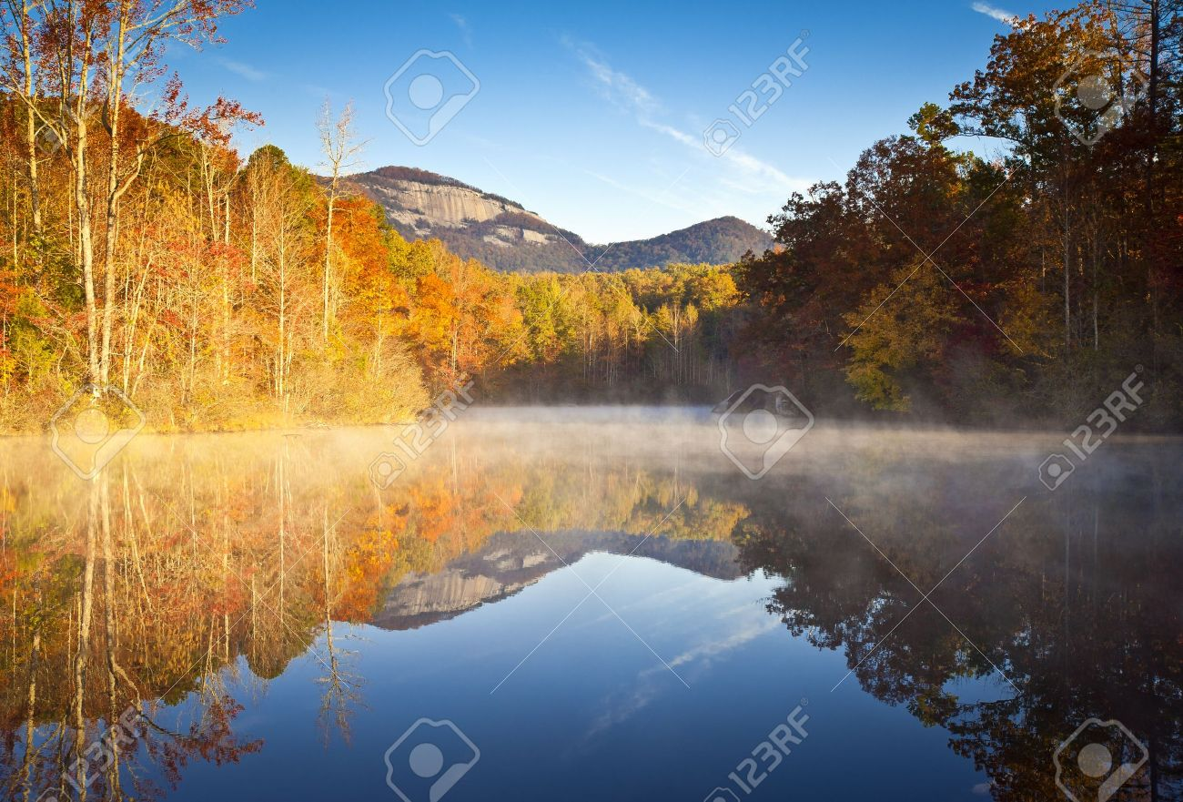 South Carolina Autumn Sunrise Landscape Table Rock Fall Foliage Reflections fog covered lake Stock Photo - 12106524