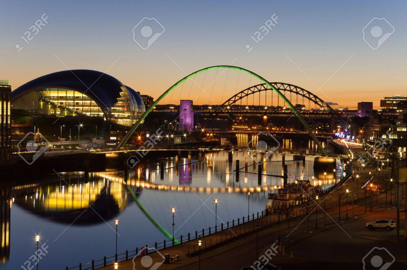 Tyne bridges at twilight / Elevated view of Newcastle and Gatehead quays just as the sun has set - 12372418