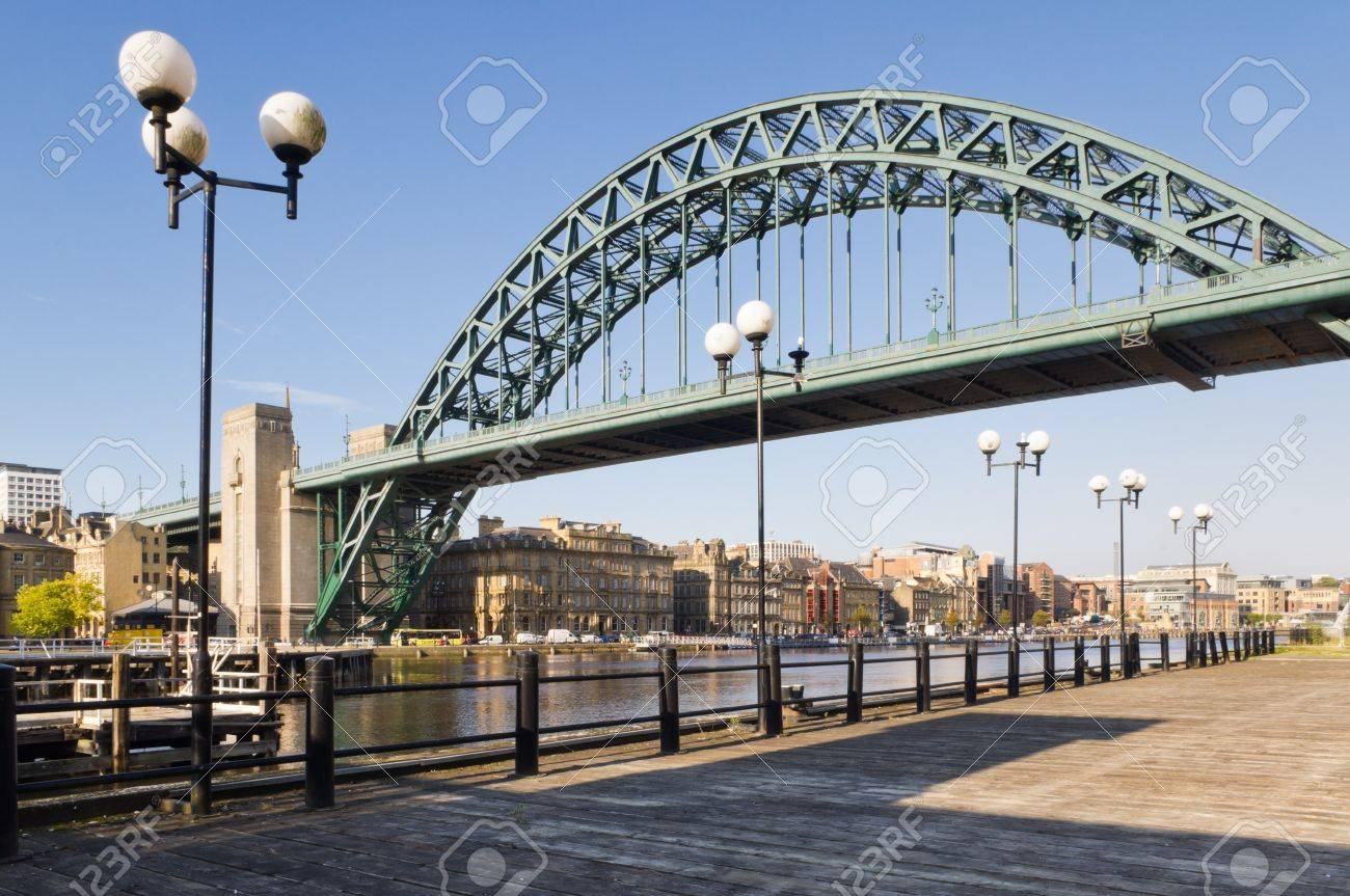 Tyne bridge with lamp posts / View of Tyne bridge with lamp posts from the south bank - 12372421
