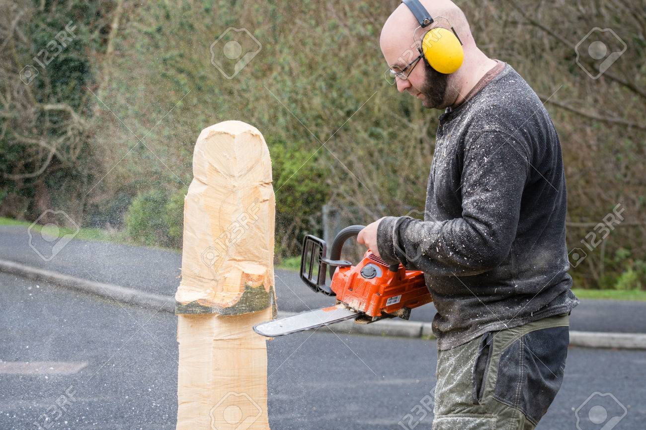 Chainsaw sculptor the making of an owl sculpture by a chainsaw