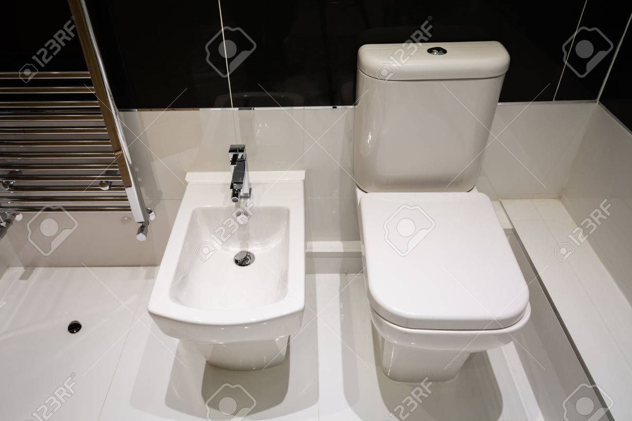 Genial Stock Photo   White Bidet And Toilet Coordinated In A Modern Bathroom