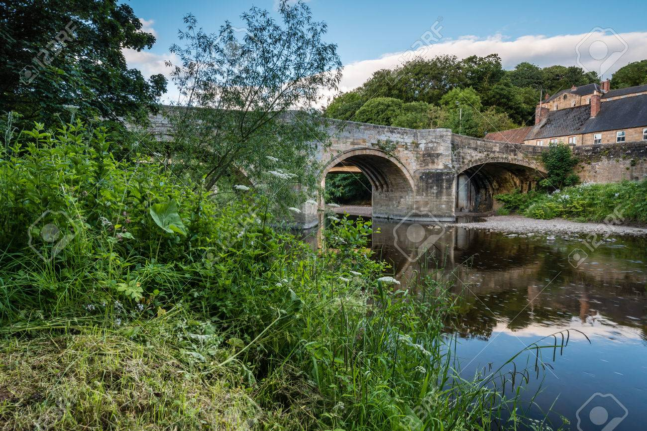 Felton Old Bridge - Felton, a small village in Northumberland, with an old bridge over the River Coquet, now closed to traffic - 61253763