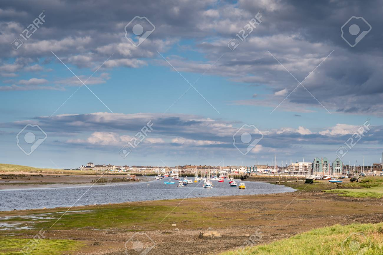 River Coquet flows passed Amble Harbour, where it meets the sea - 62405804