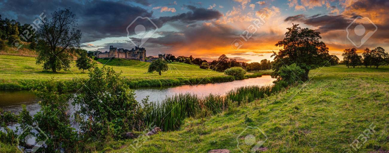 Panoramic Sunset over River Aln, which runs through Northumberland from Alnham to Alnmouth. Seen here in panorama below Alnwick Town and Castle on the skyline, as the sunsets - 84000357