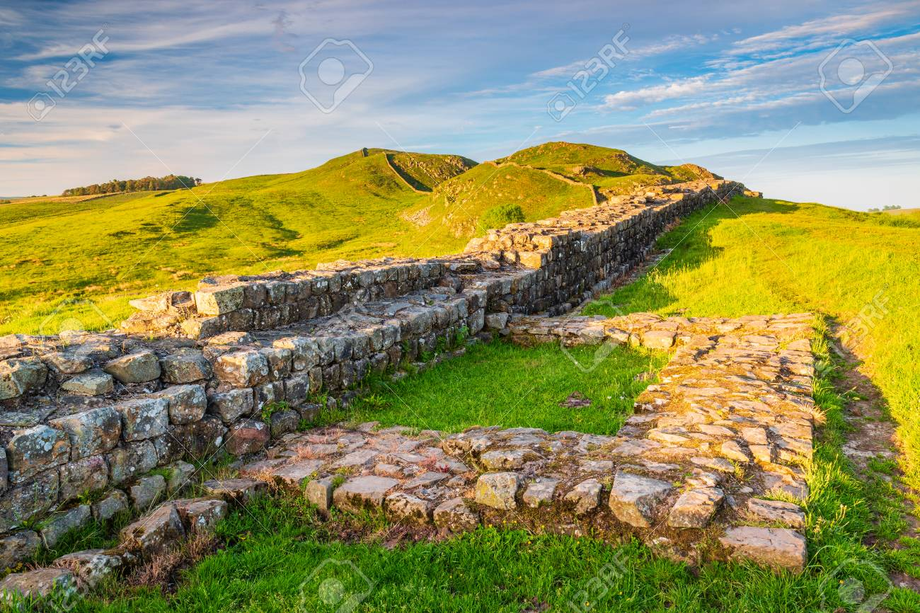 Golden Light at Hadrian's Wall Caw Gap in the beautiful Northumberland National Park. Popular with walkers along the Hadrian's Wall Path and Pennine Way - 103790763
