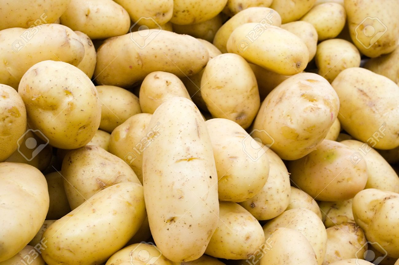 A pile of potatoes at the local grocery store