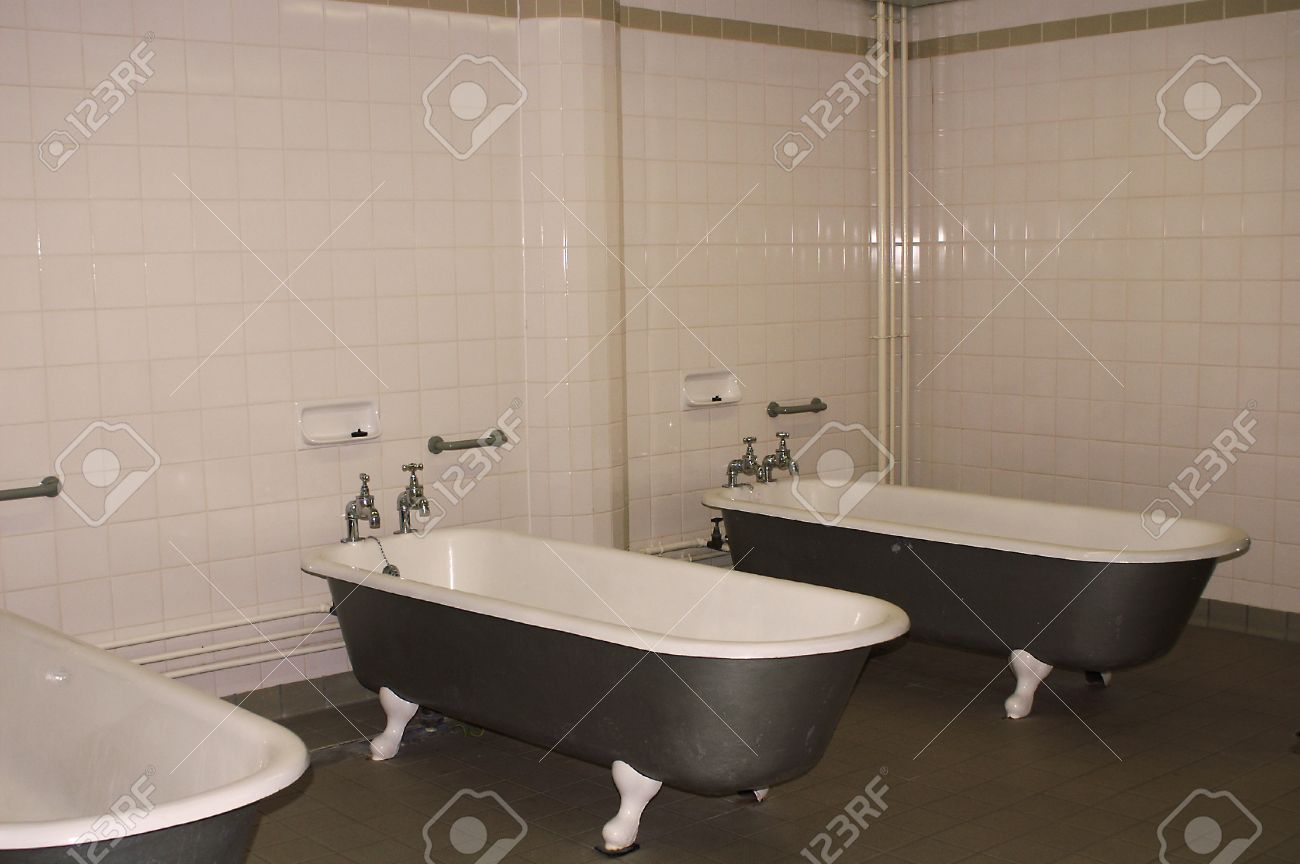 Vintage old style gym bathroom with bathtubs stock photo picture