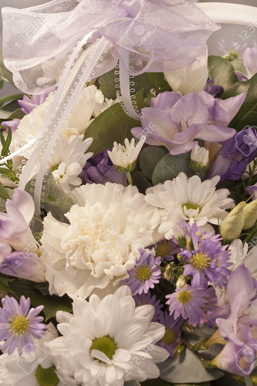 Beautiful bouquet of white lilac and purple flowers with a lace beautiful bouquet of white lilac and purple flowers with a lace ribbon stok fotoraf mightylinksfo