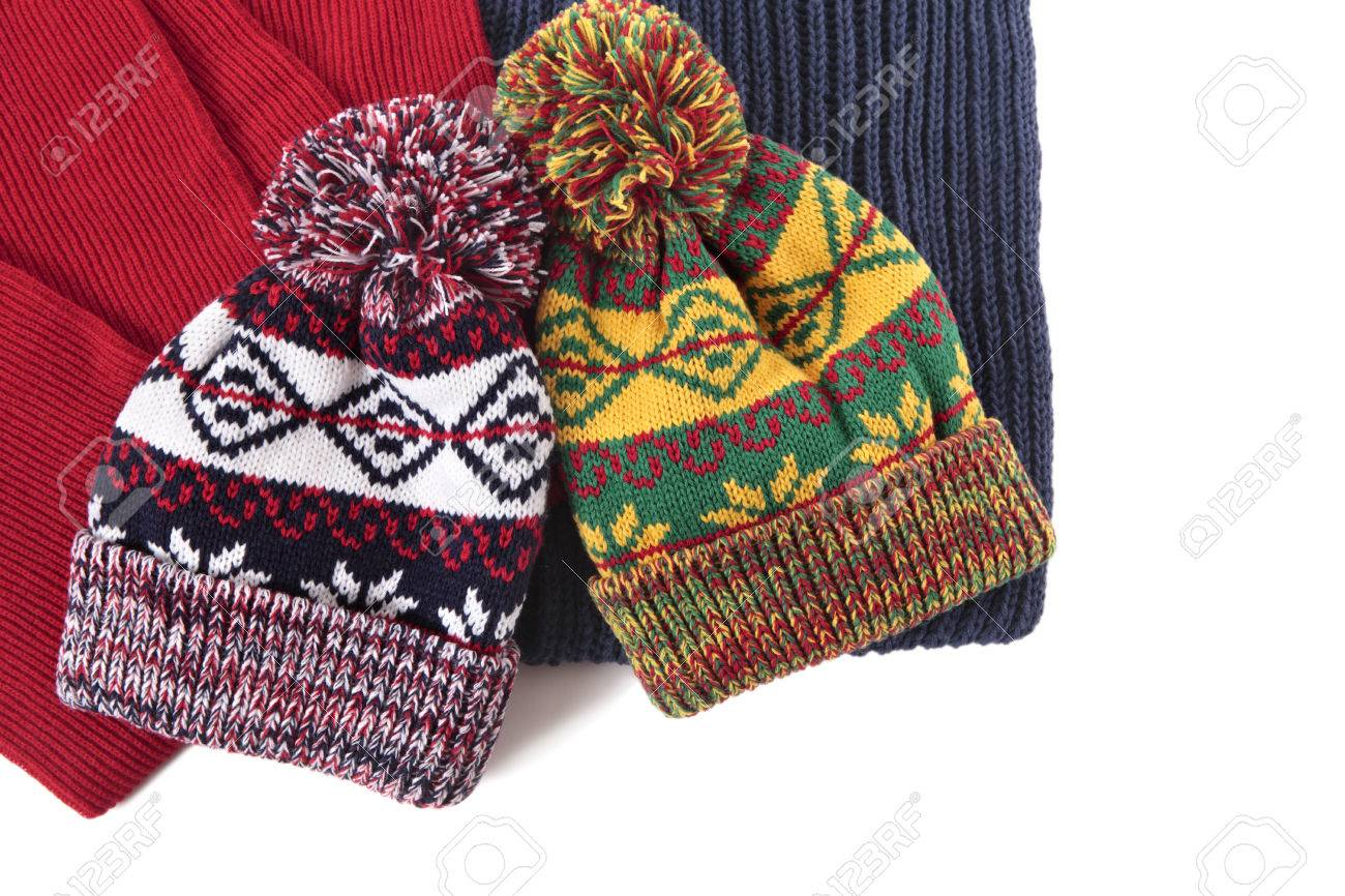 1408b03bb84 Stock Photo - Two bobble hats and scarves isolated against a white  background.