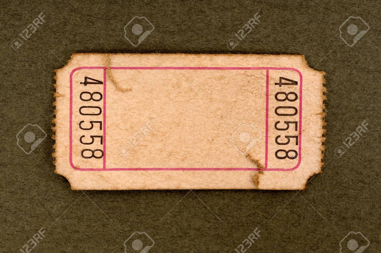 old torn blank movie or raffle ticket on a mottled brown paper background stock photo