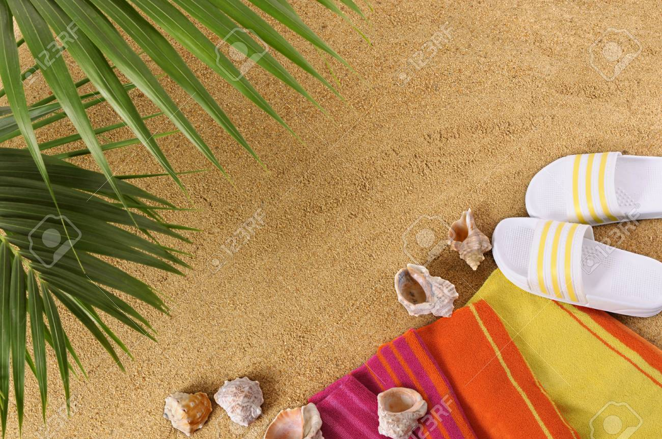 2286749626d7 Stock Photo - Tropical beach background with palm leaves