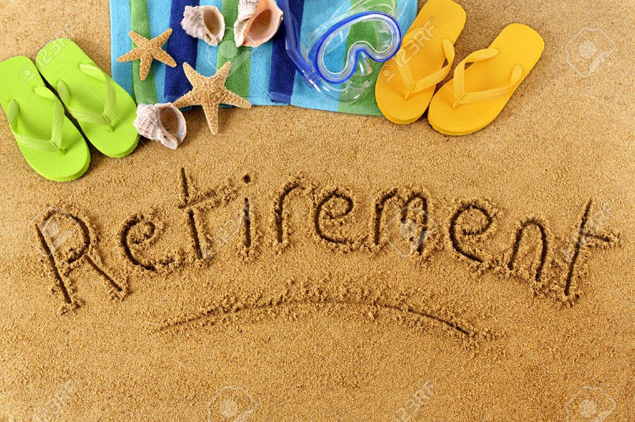 the word retirement written on a sandy beach with scuba mask