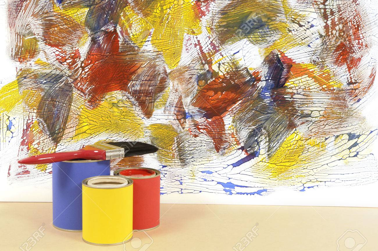 Partly finished untidy or messy painted wall with paint cans and paintbrushes. Space for copy. - 37532745