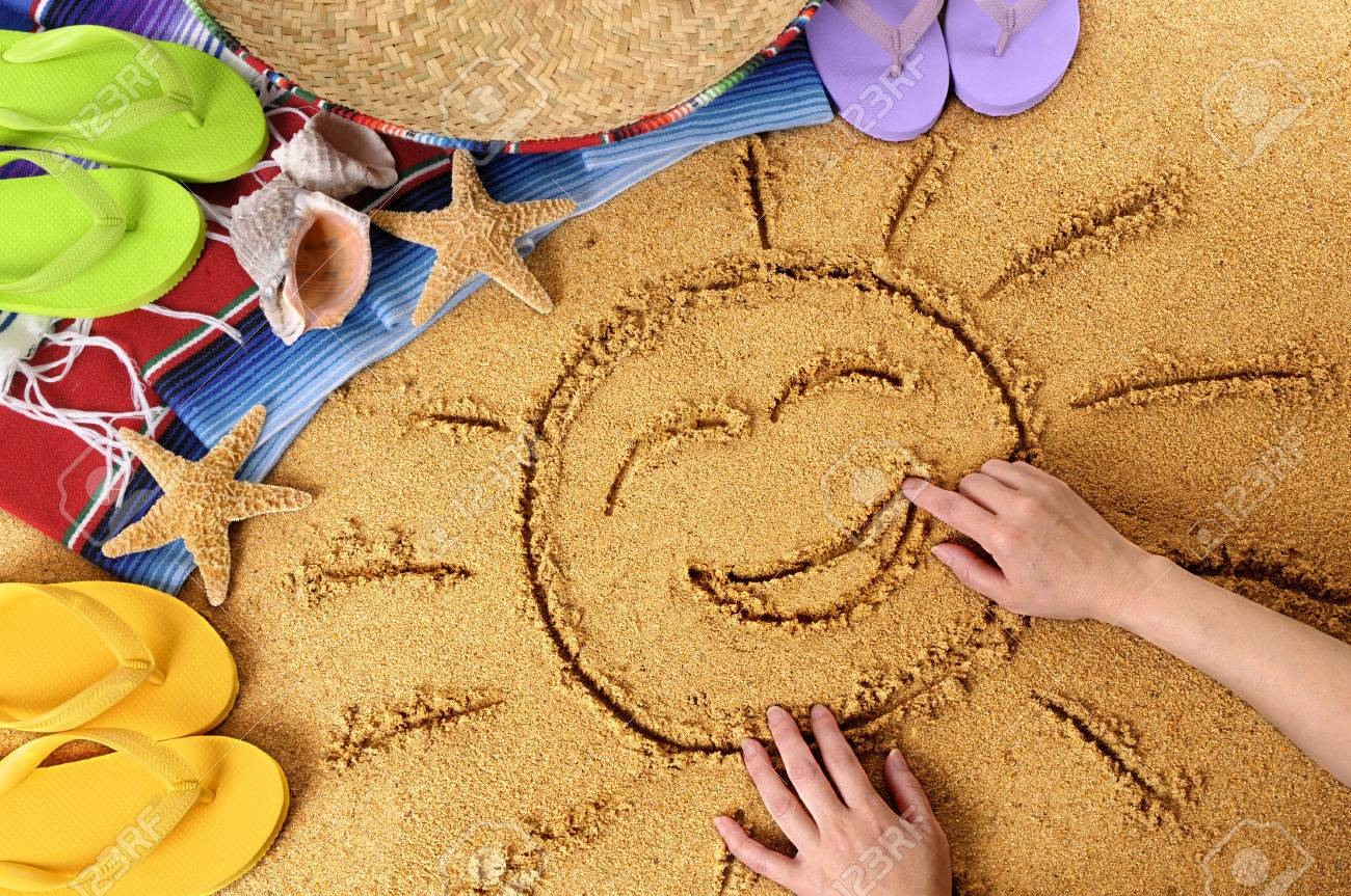 f6eeb012d8a Child Drawing A Smiling Sun In Sand On A Mexican Beach
