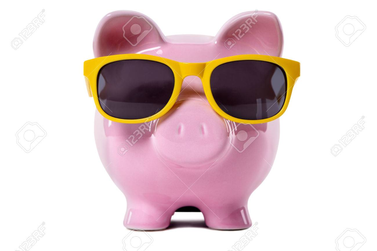Pink piggy bank wearing yellow sunglasses. Isolated on white. - 41177491