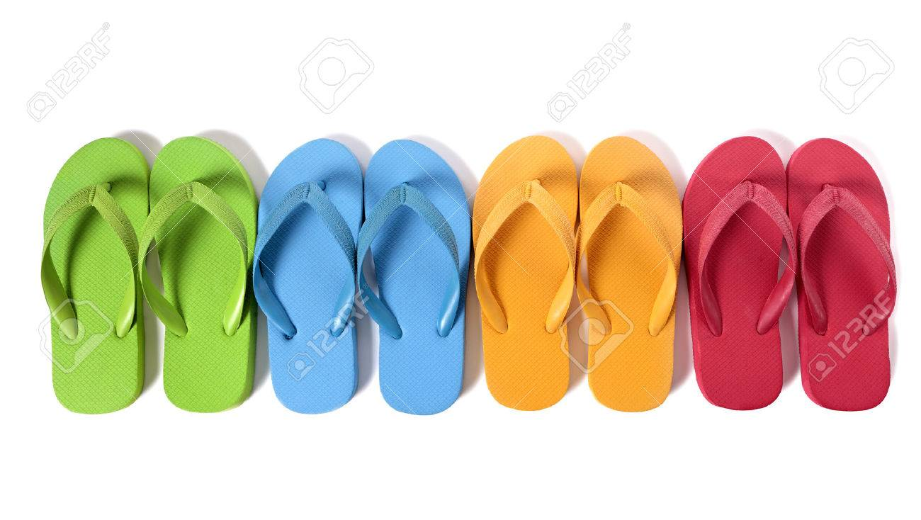 Row of colorful flip flops isolated against a white background. - 41772876
